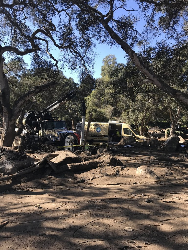 Combo trucks working in Montecito for mudslide cleanup